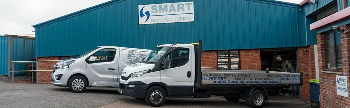 Smart Manufacturing building and company vehicles